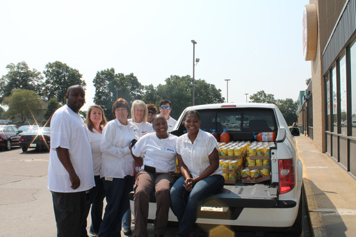 Faurecia employees deliver weekly food donations to the Community Action Program to benefit needy families in Cleveland, Miss.