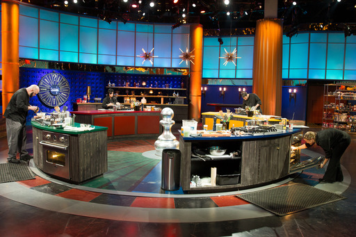 Competitors cook in the rotating kitchen during the Chef Roulette round