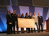 "Ram Truck brand President and CEO Reid Bigland and country music star and former FFA member Easton Corbin present National FFA Organization President Clay Sapp with $1 million donation from ""Year of the Farmer"" initiatives."