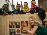 Evanna Lynch, Luna Lovegood in the Harry Potter films, poses with Hogwarts students to unveil the USPS Harry Potter Limited-Edition Forever stamp collection at The Wizarding World of Harry Potter at Universal Orlando Resort.