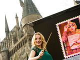 Evanna Lynch, Luna Lovegood in the Harry Potter films, casts a spell to unveil the USPS Harry Potter Limited-Edition Forever stamp collection at The Wizarding World of Harry Potter at Universal Orlando Resort.
