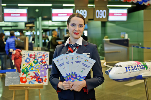 Transaero Airlines' flight attendant welcomes passengers of the first