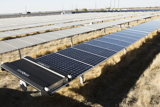 CleanFleet robot washes a row of dusty solar panels at a SunPower Oasis solar power plant in Yolo County, Calif., using less than 1/2 cup of water per panel.