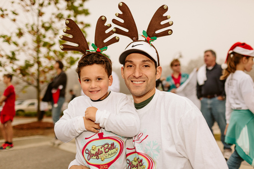 Dad and child have their antlers on and are ready to go!