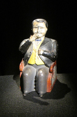 """Miracle Car, Glass Armonica, Yankee Spy"" Museum of the City of New York_A small hollow figure represents a powerful boss whose reign of corruption was challenged by a popular cartoonist on the pages of the city's daily newspapers."