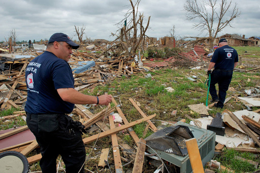 Catastrophic damage from the tornado made finding lost animals difficult for Red Star™ volunteer responders Manny Maciel and Jerry Means, but they pressed on until all were rescued.