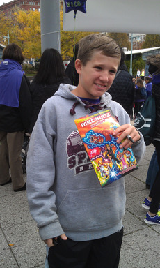 "Jack, the hero of ""Medikidz Explain Epilepsy,"" is pictured  with the book. Jack hopes that the book helps other children learn about epilepsy, the fourth most common neurological disorder in the U.S."