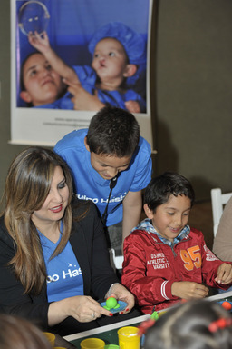 "Hasbro employees in Colombia helped to ""create"" smiles out of Play Doh for children at Operation Smile during a special celebration as part of the company's Global Day of Joy."