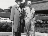 H.F. Johnson and Frank Lloyd Wright walking together on SC Johnson's campus in Racine, Wisc. in 1953