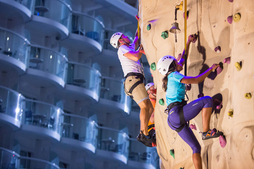 U.S. gymnast Gabby Douglas, British diver Tom Daley and Australian swimmer, Ian Thorpe race to the top of the rock wall onboard Royal Caribbean's Allure of the Seas