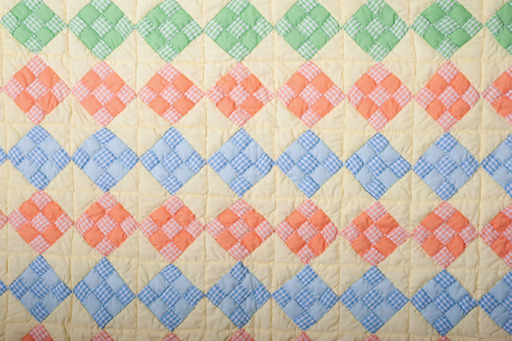 ''Baby Quilt'' by Effie Bates Cooper, 1987 from ''Home Sewn: Quilts from the Lower Mississippi Valley.'' Photograph by Susana Raab, Anacostia Community Museum.