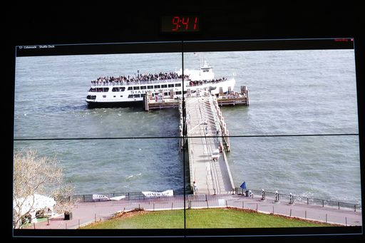 Video cameras on the Statue of Liberty monitor passenger safety as boats dock.