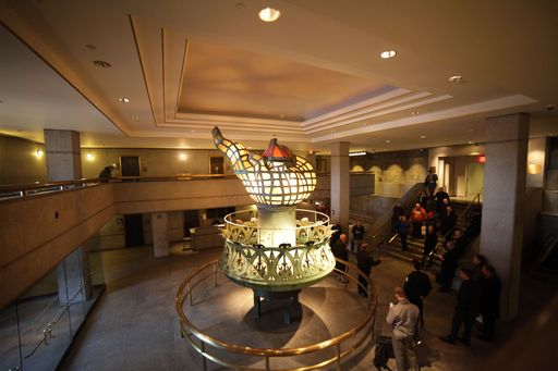 The new digital video system monitors the original Statue of Liberty torch on display.
