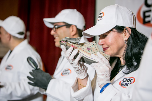 Judge Rachel Herz, an expert and author on the psychology of smell, takes a whiff of one contestant's sneakers at the 39th National Odor-Eaters® Rotten Sneaker Contest®