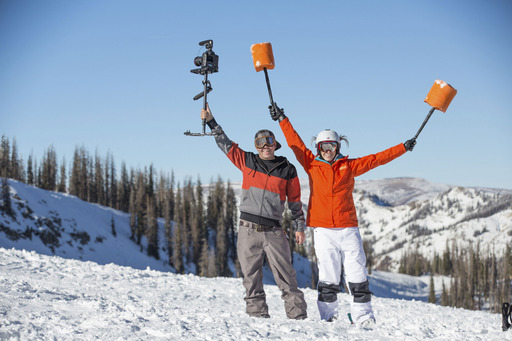 """U.S. Olympic gold medalist and mogul skier Hannah Kearney poses with YouTube sensation Devin """"Super Tramp"""" Graham during her Bear Naked® #OneUpIt video shoot at Wolf Creek Ski Area"""