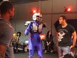 SCAD undergraduates Sekani Solomon and Jason Diaz use motion capture technology and the athleticism of a local football player to animate Cleatus the Robot's precise movements.
