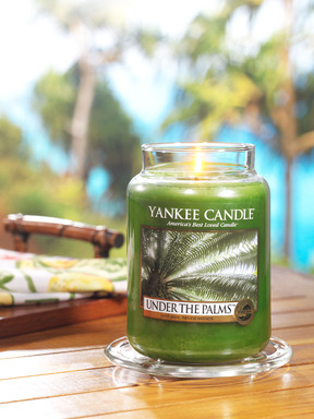 Yankee Candle's new Under the Palms(TM) fragrance features a lush green scent of sea grass, palm leaves and island coconut.