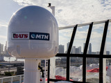 Using the fastest data path, Norwegian Getaway uses this broadband antenna tracking and stabilization system to lock onto an access point in-port to switch from satellite to terrestrial connectivity.