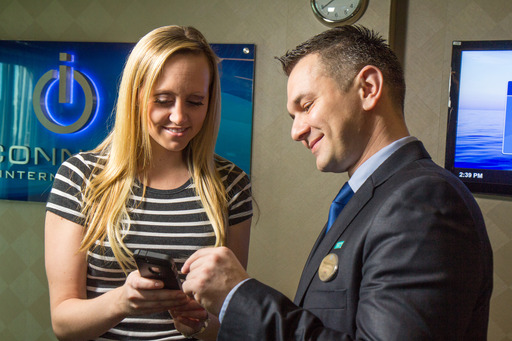 The Internet Manager on Norwegian Getaway demonstrates to a passenger the higher performance connectivity being delivered by the new MTN hybrid communications network.