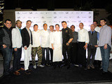 Akira Back, Michael Mina, Julian Serrano, Todd English, Royden Ellamar, Jason Smith and other Bellagio chefs posed with Bon Appetit's Adam Rapoport during Vegas Uncork'd