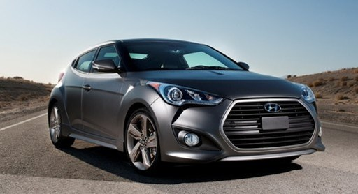With its second consecutive win, the 2014 Hyundai Veloster Turbo excels in nearly all 5-Year Cost to Own categories, ousting the Ford Focus ST and Subaru Impreza for this year's top spot in the sporty compact car segment.