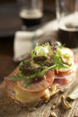 Enda's Ploughman's Sandwich features ham, Dubliner cheese and salad fixings,  piled onto rustic bread. Serve it with a pint for St. Patrick's Day.