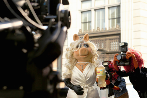 "Miss Piggy―diva, fashion icon and star of Disney's ""Muppets Most Wanted""―is photographed by paparazzi (aka Animal) during the filming of Lipton's ""Be More Tea™"" ad, debuting during the Academy Awards, March 2, 2014."