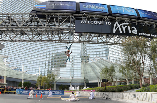 Aerialists Andrew and Kevin Atherton thrilled spectators as they performed outside ARIA's porte cochere, while suspended 32' in the air, on March 3, 2014 Photo Credit: Denise Truscello/WireImage