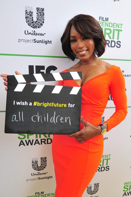 Angela Bassett calls ACTION! to create a brighter future for all children on the Yellow Carpet presented by Unilever Project Sunlight during the 2014 Film Independent Spirit Awards