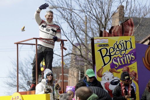 "Andy Cohen, host and executive producer of Bravo Media's ""Watch What Happens Live,"" waves to the crowd at the 21st annual Beggin'® Pet Parade Sunday, Feb. 23, 2014 in St. Louis."