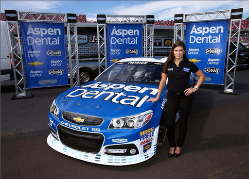 Danica Patrick with her new Aspen Dental sponsored car, which she will race for the first time in this weekend's Kolbalt 400 NASCAR Sprint Cup Series race