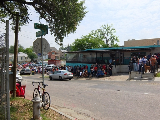 BBQ aficionados wait in line for hours to get a taste of Franklin Barbecue in Austin, TX, the #1 U.S. BBQ joint according to TripAdvisor. (A TripAdvisor traveler photo)
