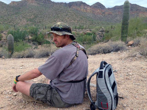 Randy Shepherd takes a break to take in the scenery at Tonto National Forest. In his backpack is the Freedom portable driver that powers the SynCardia Total Artificial Heart.