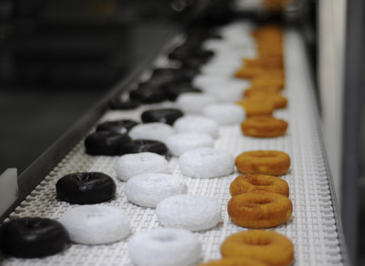 Entenmann's Frosted and Softee Donuts fresh off the assembly line