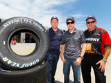 "NASCAR driver Matt Kenseth and Tire Specialist Jerold Shires receive a delivery of Goodyear's ""Support Our Troops"" tires from Goodyear Racing's James Heath, a retired Marine at Charlotte Motor Speedway as Goodyear kicks off ""Goodyear Gives Back."""