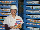 Valeria Albores, Plant Manager at Bimbo Bakeries USA, holds a box of freshly-made Entenmann's Little Bites at the manufacturing facility in Albany, NY