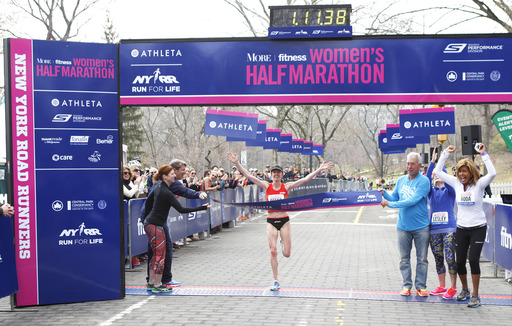 U.S. Olympian Deena Kastor crosses the finish line in 1:11:38 to win the 11th Annual More Magazine/Fitness Magazine Women's Half-Marathon on April 13, 2014. Kastor broke the event record.