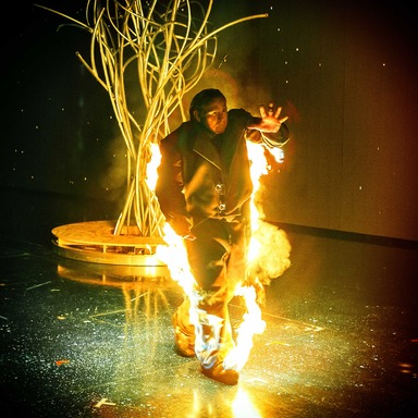 Cirque du Soleil performer ignites himself onstage during One Night for ONE DROP. PHOTO CREDIT: TOMO