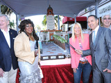 Efrem Harkham, founder of Luxe Hotels, Beverly Hills Mayor Lili Bosse, Beverly Hills Vice Mayor Julian A. Gold, R&B legend Martha Reeves and Rodeo Drive Committee President Jim Jahant prepare to cut a 24-foot long Guittard Chocolate cake.