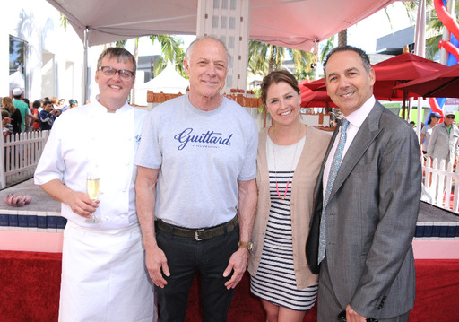 Guittard Chocolate Company president and CEO Gary Guittard, Guittard Marketing Manager Amy Guittard, Guittard Corporate Chef Donald Wressell and Luxe Hotels founder Efrem Harkham present a 15,000-slice cake on the Beverly Hills Centennial.