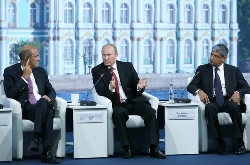 "Alstom SA chairman and CEO Patrick Kron, Russia's president Vladimir Putin, and Sun Group vice chairman Shiv Vikram Khemka at a plenary session ""Sustaining Confidence in a World Undergoing Transformation"""