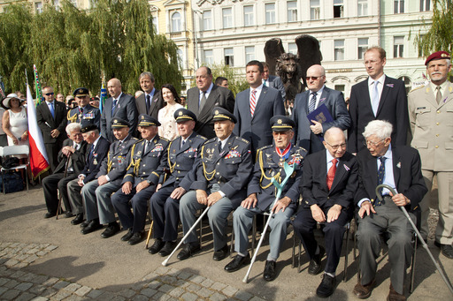 RAF veterans (seated) with distinguished guests and dignitaries, including Rt Hon Sir Nicholas Soames and Air Chief Marshal Sir Stuart Peach