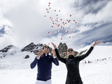 Swiss tennis champion Roger Federer and US ski racer Lindsey Vonn at an exhibition match on the Aletsch glacier after the opening of the LINDT Swiss Chocolate Heaven at the Jungfraujoch on 3,454 metres above sea level, Wednesday, 16 July 2014