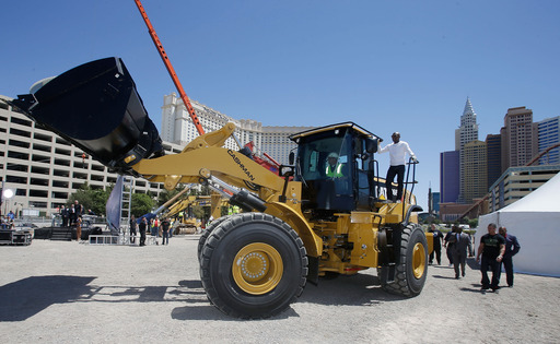 "W B C Welterweight World Champion Floyd ""Money"" Mayweather makes surprise entrance to groundbreaking of AEG's and MGM Resorts' Las Vegas Arena on May 1, 2014 via a heavy construction vehicle."