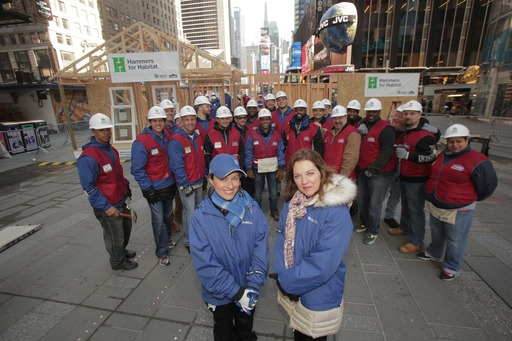 Leslie Morris (right) and her daughter, Stefani, framed the walls of their new home alongside volunteers from eight Lowe's stores and Habitat for Humanity in Times Square.
