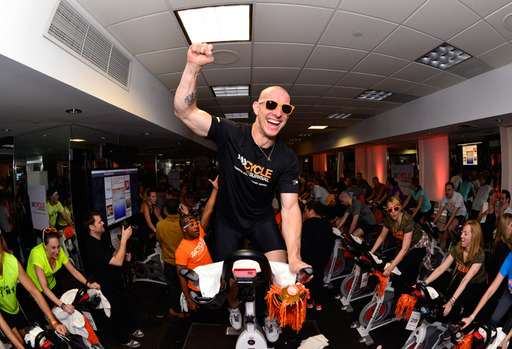 An Equinox instructor leads riders at one of the 2014 events. Equinox is the founding partner of Cycle for Survival.