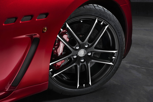 Dual cast Brembo brakes and sport-tuned MC suspension are standard on the GranTurismo MC Centennial Edition. Wheel choice of MC or Trofeo designs offer a center medal-shaped centenary logo.