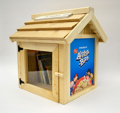 Alpha-Bits sponsored Little Free Library includes a collection of favorite children's books
