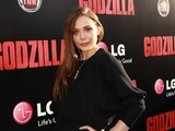 Elizabeth Olson strikes a fierce pose on the red carpet at the world premiere of Godzilla, sponsored by LG Electronics and the new LG G Flex