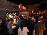 Guests at the Los Angeles Godzilla premiere after party lined up to enter the LG store experience, where they were offered the chance to interact with LG G Flex, the world's first, curved flexible smartphone.
